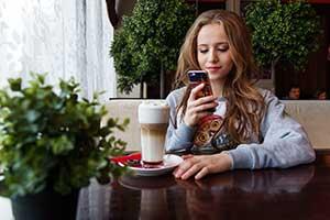 teenager messaging on phonephone